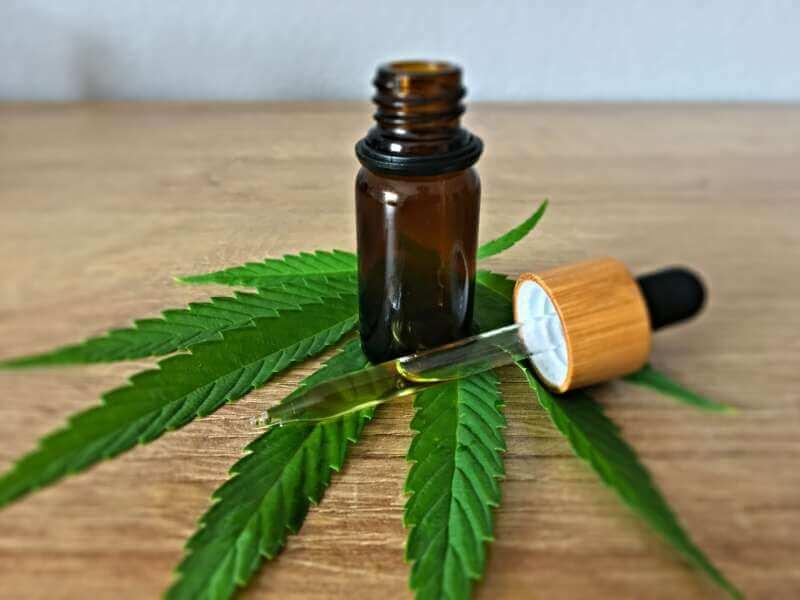 CBD Oil and cannabis leaf